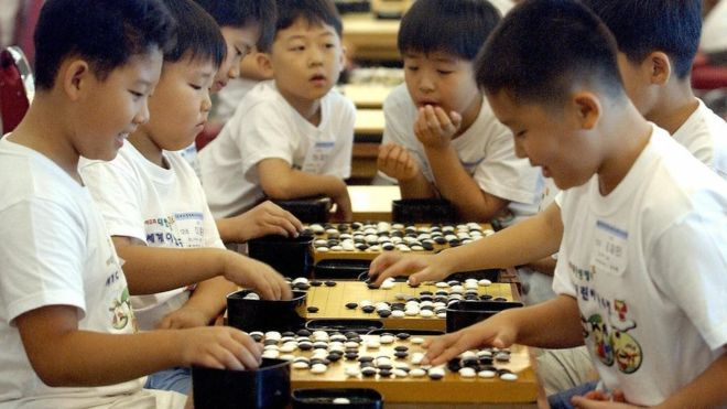Chinese Students Playing Go Game
