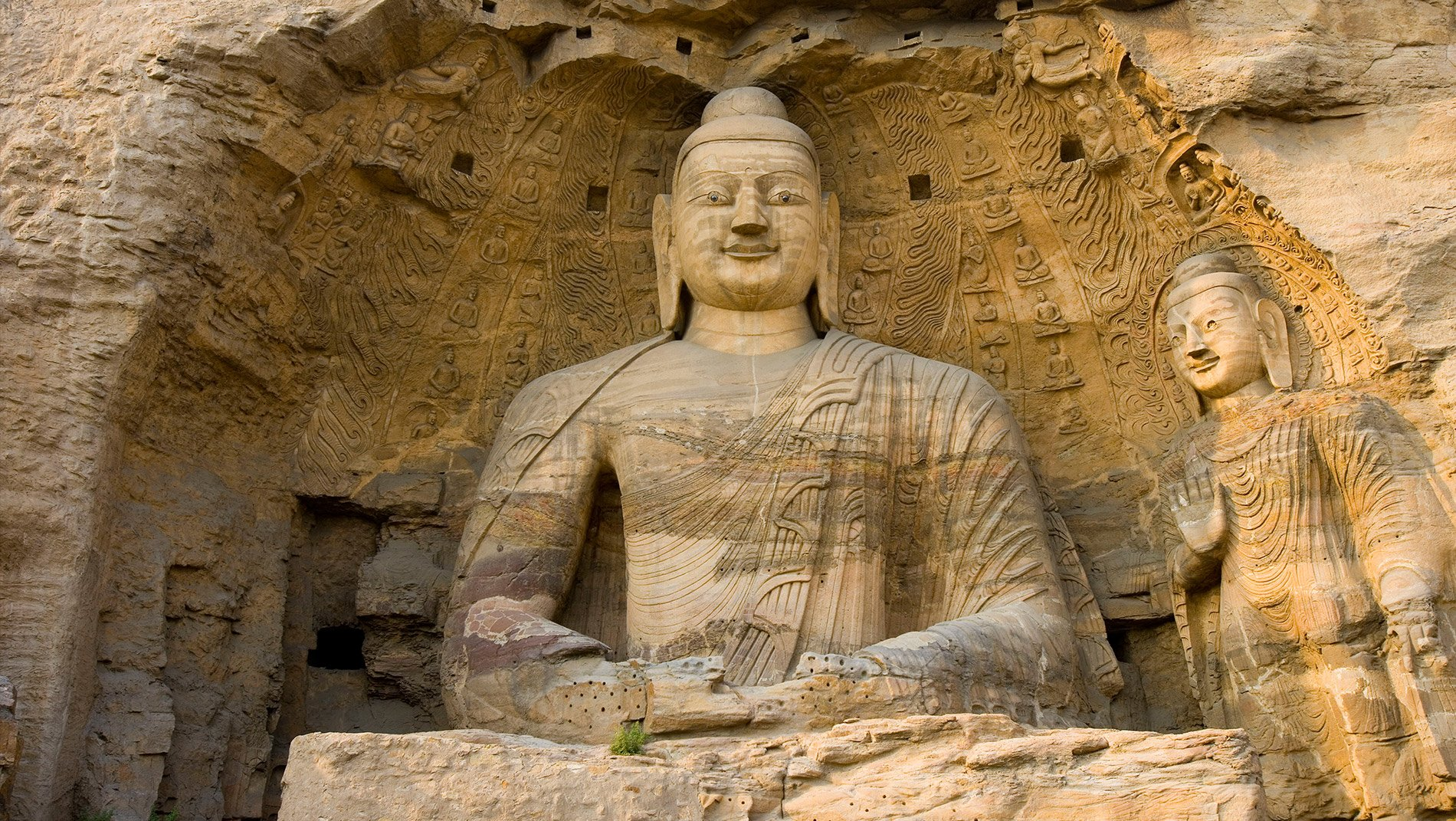 Yungang Caves~With over 250 caves and 50,000 sculptures, carved out over more than a century, the Yungang grottoes are an outstanding achievement of Buddhist architecture and art.